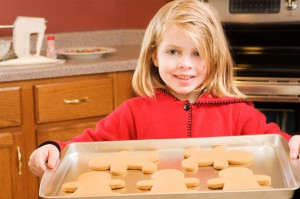 little-girl-holiding-cookies