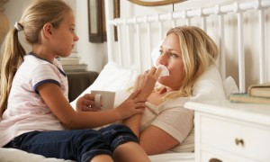 Daughter Visiting Sick Mother In Bed At Home