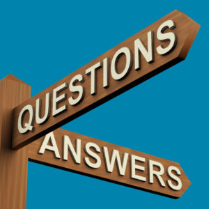 Questions Or Answers Directions On A Wooden Signpost